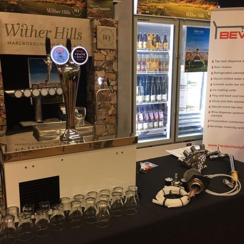 Sting Countertop Cooler With Cobra 2-Way Font On Display For Bevtech Solutions. Charlie 1-Way Font Also Featured (dispensing Wine)